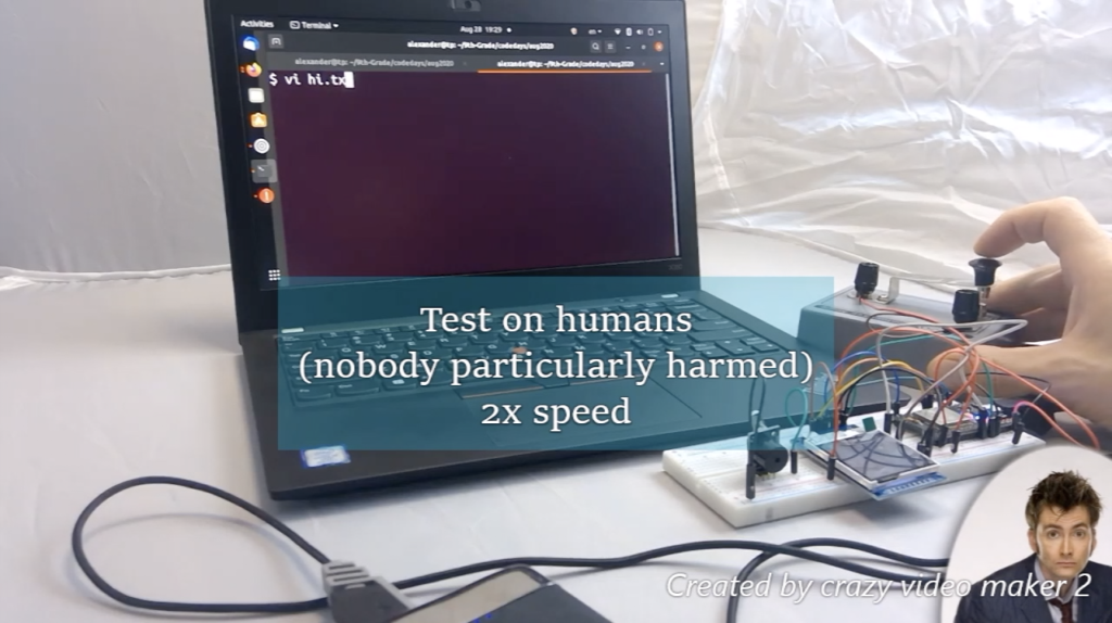 "Photo of an electronics project in front of a computer, with the text ""test on humans (nobody particularly harmed) 2x speed"". Dr Who is in the corner."