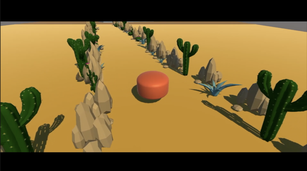 A screenshot of a game, with an orange cylinder in the middle of a desert.